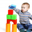 Boy builds a house out of toy blocks — Stock Photo
