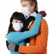 Man embraces a woman wearing masks, flu, — Stock Photo