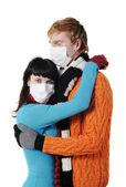 Man embraces a woman wearing masks, flu, — Stock Photo