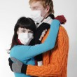 Man embraces a woman wearing masks, flu, - Stock Photo