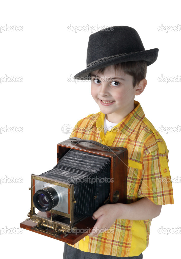 Little boy with an old camera on the white background — Stock Photo #2509679