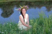 Sad girl at the river — Stock Photo