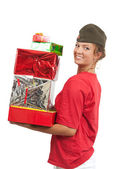 Girl in garrison cap with christmas gift — Stock Photo