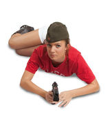 Girl in overseas cap holding gun — Stock Photo