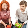 Adult women and teen boy giving gifts — Stock Photo