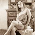 Blonde girl in vintage flat — Stock Photo #1113774