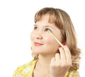 Girl cosmetics doing a make-up — Stock Photo