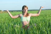 Yoga over meadow — Stock Photo