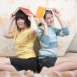 Two smiling reading girls — Stock Photo