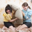 Two joy girl on sofa — Stock Photo