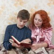 Royalty-Free Stock Photo: Mother and son reading