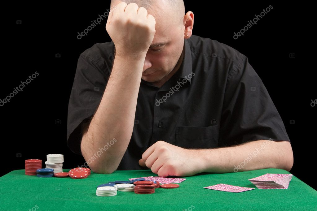 Poker gambler in black shirt close-up. Focus on the hand and clips.  losings — Stock Photo #1149350