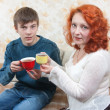 Son and mom drink tea at home — Stock Photo