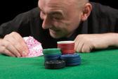 Man playing in casino poker — Stock Photo