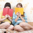 Girls with books indoor - Stock Photo