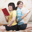 Two smiling girls indoors - Stock Photo