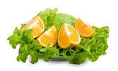 Lettuce and halfs of orange — Stock Photo