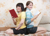 Two smiling girls indoors — Foto de Stock