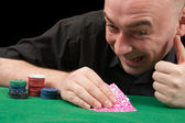 An adult man playing poker . Isolated ov — Stock Photo