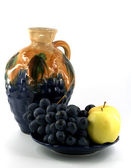 Decanter with fruits — Stock Photo