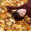 Stock Photo: Girl in the autumn leafs