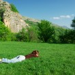 Girl resting on the meadow — Stock Photo