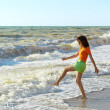 Stock Photo: Girl play on the beach