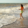 Girl play on the beach — Stok fotoğraf
