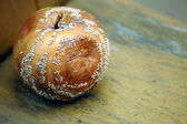 Rotten apple on a bench — Stock Photo