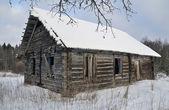 Old broken house in winter — Stock Photo