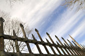 Metal fence against the spring sky — Stock Photo