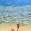 Ma and son playing on beach on backgroun — Stock Photo