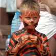 Litle boy bodyart tiger on the beach — Stock Photo
