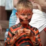 Litle boy bodyart tiger on the beach — Stock Photo