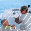 Little boy and captain on the boat — Stock Photo
