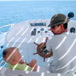 Little boy and captain on the boat 2 — Stock Photo