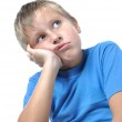 Portrait of young boy sitting isolated — Stock Photo #1103228