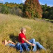 Young boy and ma lying outdoors — Stock Photo