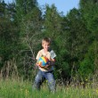Little boy with a ball in the park — Stock Photo