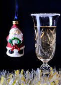One glass of champagne with little Santa — Stock Photo