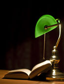 Electric green table lamp and book — Stock Photo