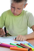 Boy drawing on paper — Stock Photo