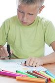 Caucasian boy drawing — Stock Photo