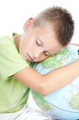 Boy has tired and sleeps on globe — Stock Photo