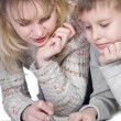 Mother with her son drawing — Stock Photo