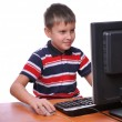 Young man using a computer — Stock Photo