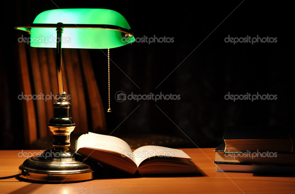 Electric green table lamp and opened book — Stock Photo #1945809