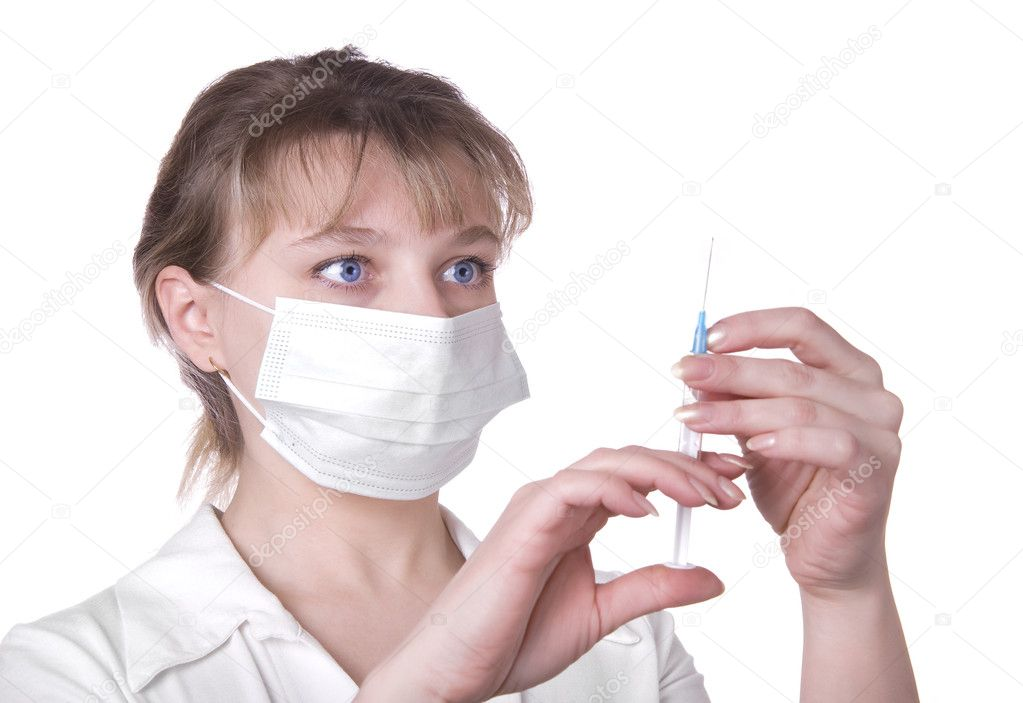 Young nurse in mask with syringe, isolated on white background — Stock Photo #2414855
