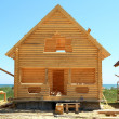 Wooden house on the beach - Stock Photo