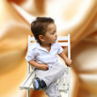Boy sitting on a chair — Stock Photo